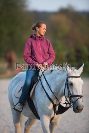 horseback rider woman riding a horse