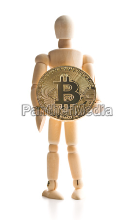 bitcoin currency and wooden puppet
