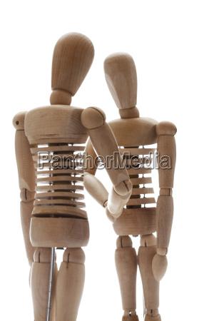 holzfiguren mit handschlag