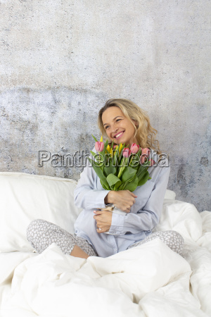 young blonde pretty woman in bed