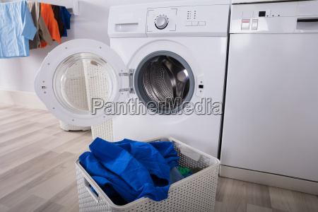 empty washing machine with pile of