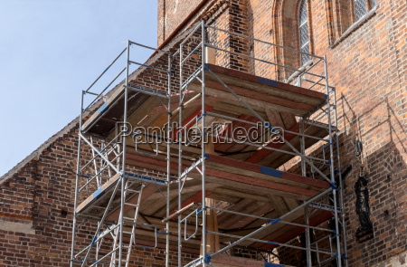 scaffolding in front of the wall