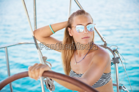 attractive girl on sailboat