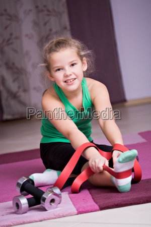 8 year old girl exercises with