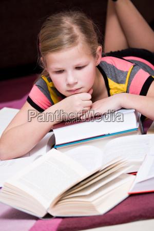 11 year old girl lying between