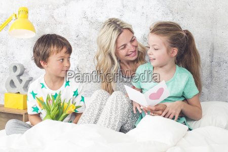 happy family children congratulate their