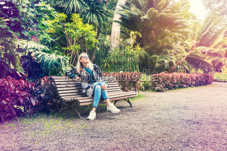 woman sitting and relaxing on bench