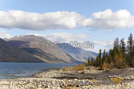 kusawa lake lake behind the mountains