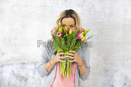young pretty woman with a bouquet