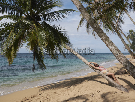 woman 45 relaxes lying on a