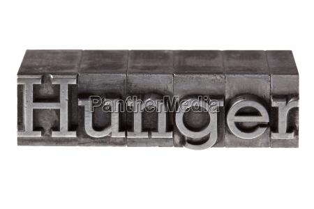 alte bleilettern bilden das wort hunger