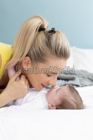 beautiful young mother with yellow shirt