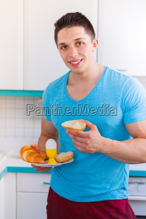 breakfast eat young man in the