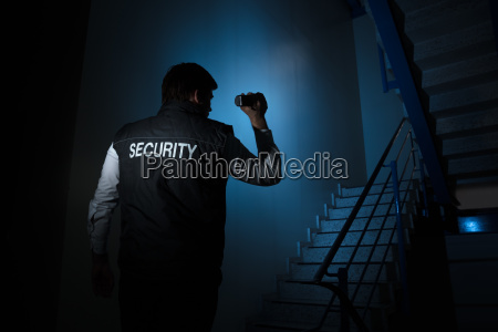 security guard standing near stairway