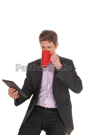 business man drinking his coffee in