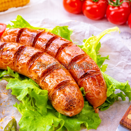 grilled krakow sausage with boiled corn