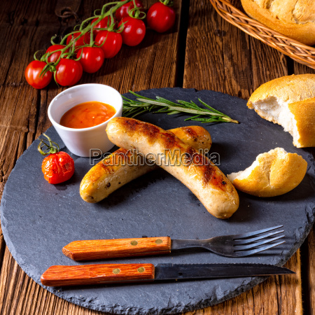 rustic bratwurst with ketchup and fresh