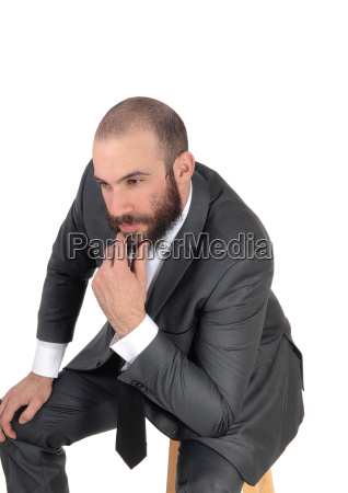 business man with hand on chin