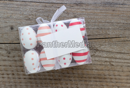box of easter eggs with dots