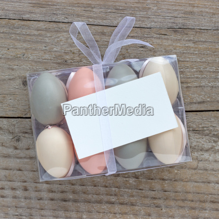 box of pastel colored easter eggs