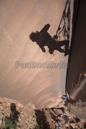 shadow of climber taking picture indian