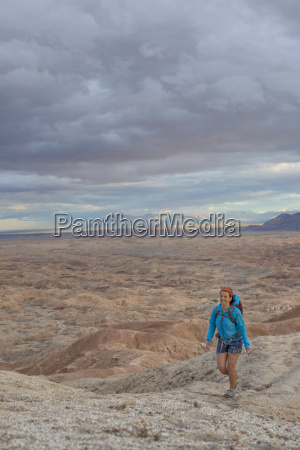 adult woman hiking in badlands section