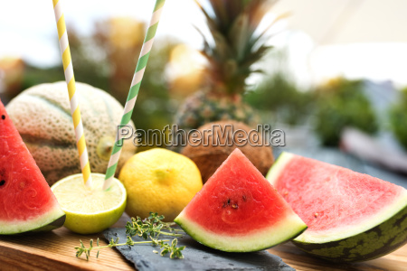 exotic summer fruits on a wooden