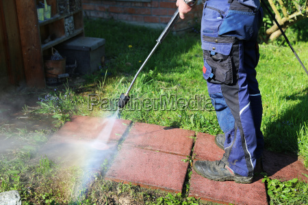working with the pressure washer