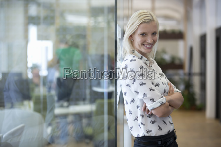 portrait of businesswoman standing in modern