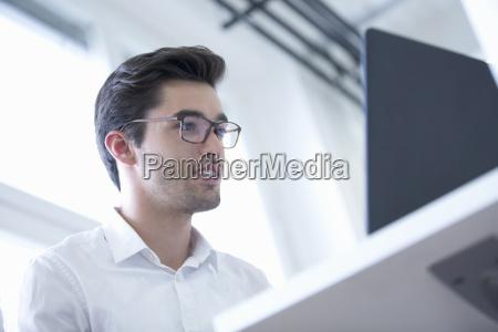 businessman at desk using laptop in