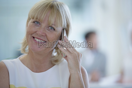 portrait of businesswoman making phone call