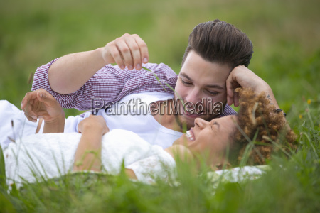 romantic young couple relaxing in countryside