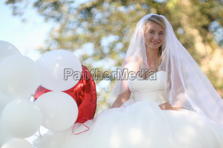 portrait of bride outdoors with balloons