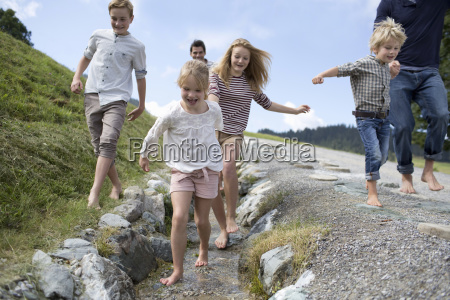 father and children on countryside path