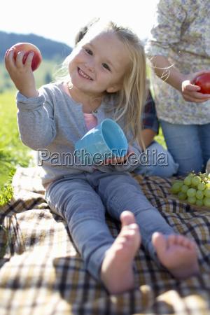 portrait of young girl enjoying picnic
