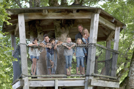 father with children in adventure playground