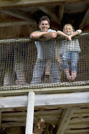 father with daughter in adventure playground