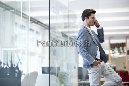 businessman making phone call in modern
