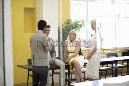 businesspeople having informal meeting in modern
