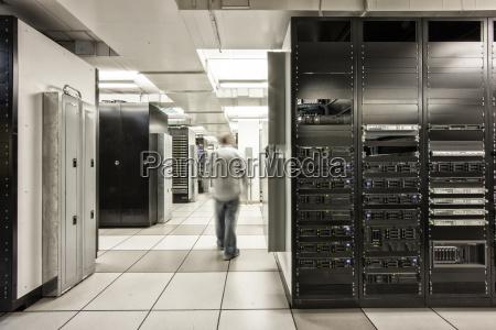 computer server room racks with technician