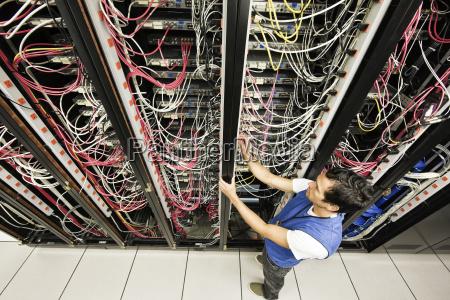 caucasian male technician working on a