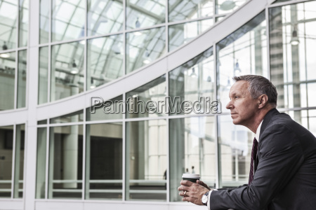 caucasian businessman looking from a balcony