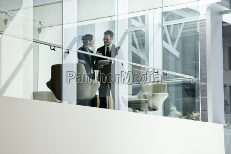 businessman and woman standing behind a