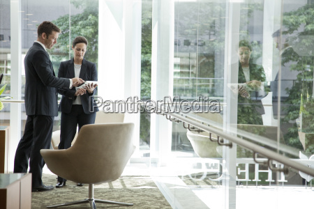 caucasian businessman and woman meeting in