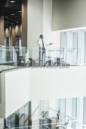 black businessman on the phone standing
