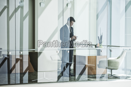 businessman standing behind a conference room