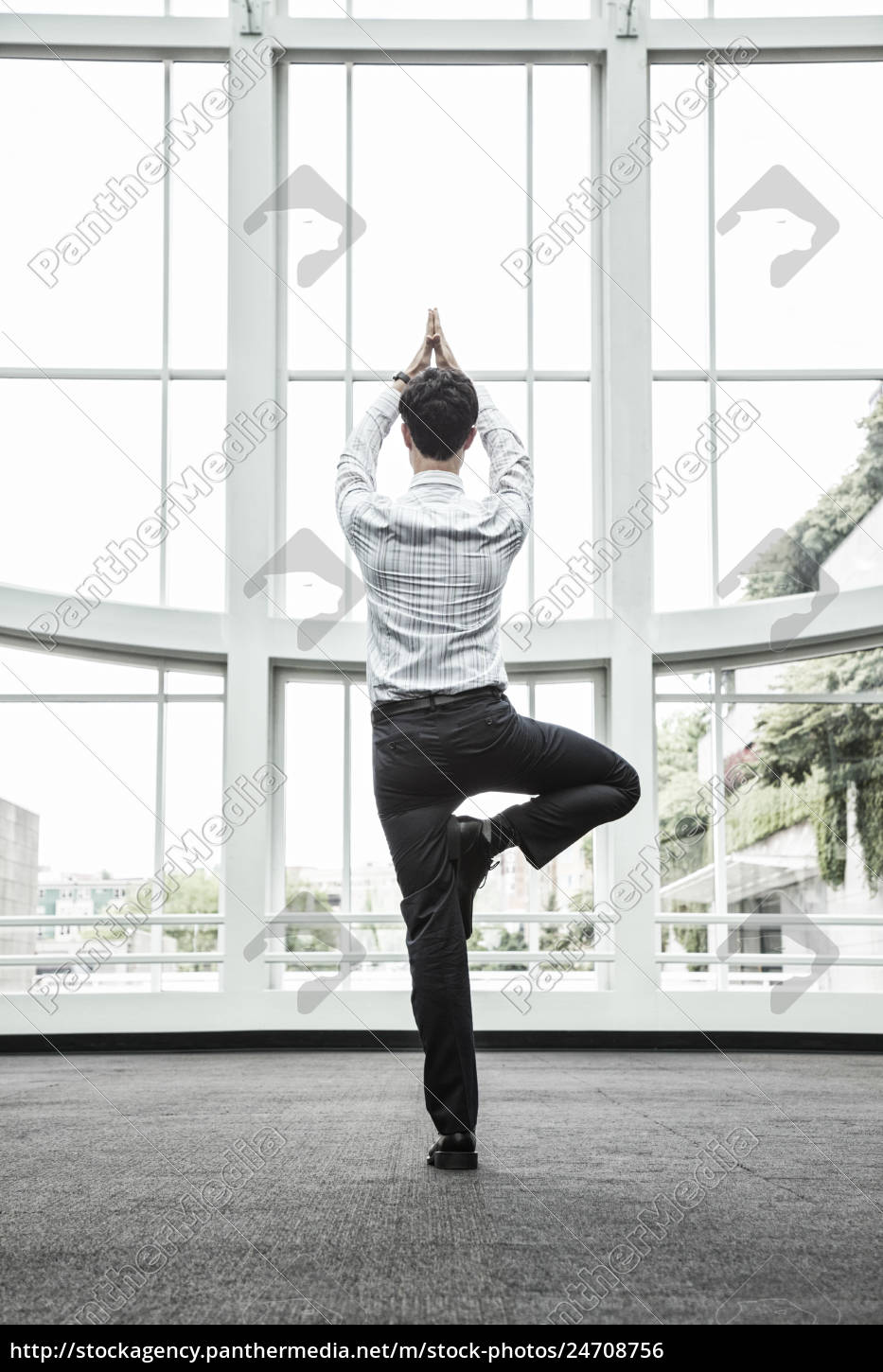 businessman, relaxing, doing, a, yoga, pose - 24708756