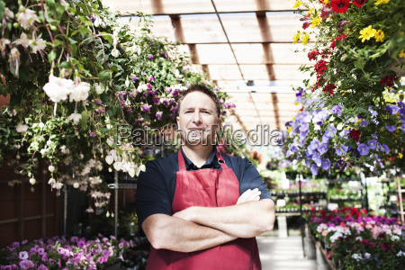 caucasian man nursery owner standing with