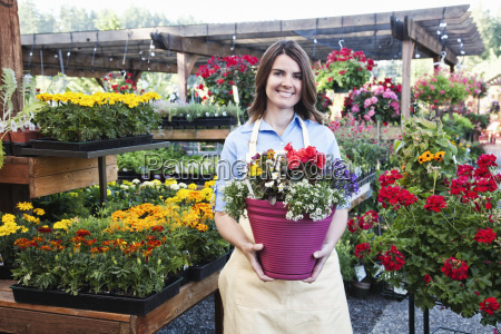 garden centre nursery employee with potted