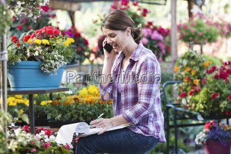 caucasian woman employee of a nursery